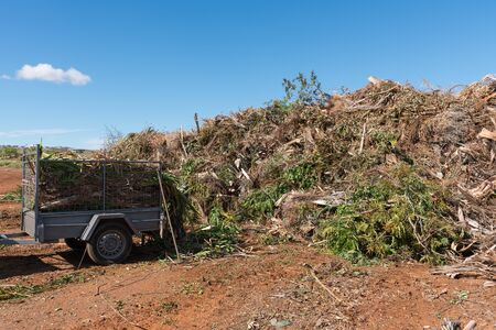 Green waste collection centre with trailer of rubbish to be emptied
