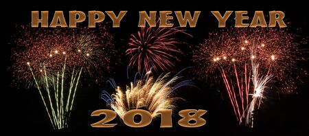 Fireworks display with words Happy New Year 2018 Stock Photo