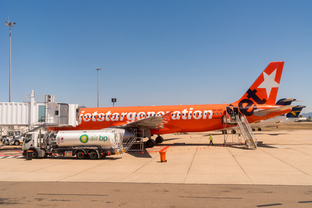 Townsville, Australia - October 10, 2018: A Jetstar airplane is refueled by Air BP on a hot day at Townsville Airport, Queensland, Australia.