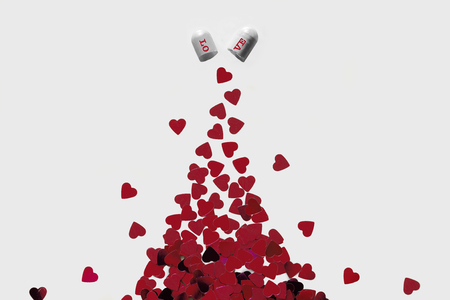 Capsule full of red hearts concept Stock Photo