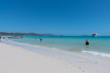 Hamilton Island, Australia - November 7, 2017: Tourists enjoying swimming and snorkelling on beautiful Whitehaven Beach in the Whitsundays in Queensland
