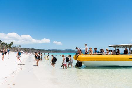Hamilton Island, Australia - November 7, 2017: Tourists coming ashore on beautiful Whitehaven Beach in the Whitsundays, Queensland, Australia