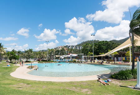 Airlie Beach, Australia November 5, 2017: Tourists and locals enjoy the Airlie Beach Lagoon on a warm summer day