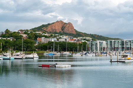 Boats moored in the Townsville Marina with iconic Castle Hill in the background