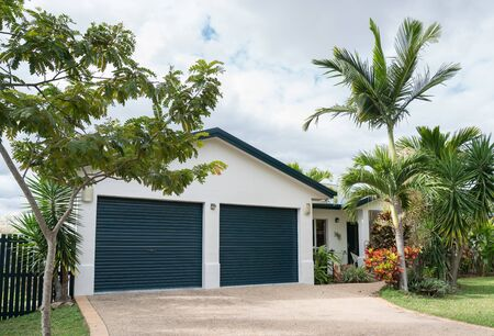 Newly painted rendered house with double garage