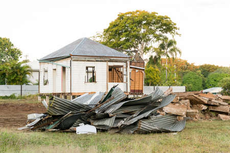 Corrugated iron roof sheeting in pile on building site with machinery Archivio Fotografico