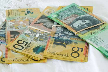 Bundles of Australian currency fifty and one hundred dollar notes 版權商用圖片