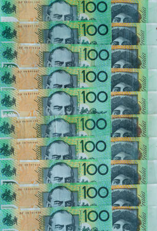 Australian money  $100 notes lined up to make background