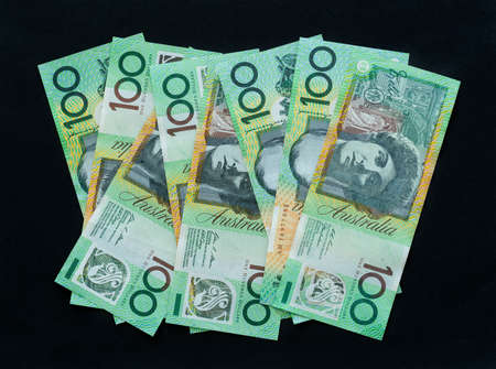 One hundred dollar notes on black background, Australian currency Archivio Fotografico