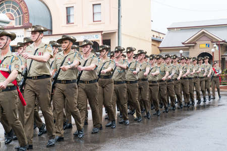 Charters Towers, Australia - April 25, 2019: Soldiers marching on a wet and rainy Anzac Day