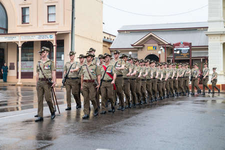 Charters Towers, Australia - April 25, 2019: Soldiers of the 1st Battalion, Royal Australian Regiment (1 RAR) marching in the rain on Anzac Day