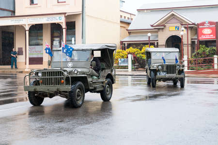 Charters Towers, Australia - April 25, 2019: Returned soldiers driving old army jeeps in Anzac Day parade