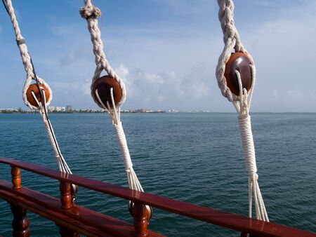 Cancun Bay  Cruise:  Looking over the rail toward shore during an evening dinner cruise.