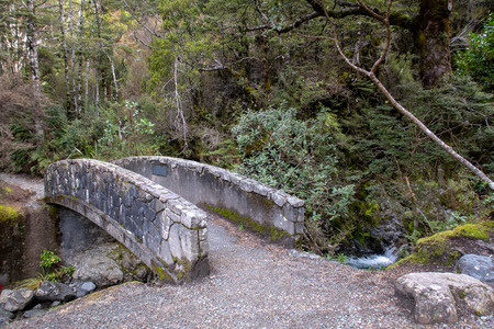 Stone bridge over a stream in a national park