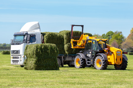 Geraldine, Canterbury, New Zealand - October 21 2018: A truck is loaded up with fresh hay bales on a farm in springtime