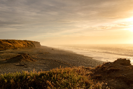 The sun rises over the coastline at Dorie in Canterbury, New Zealand