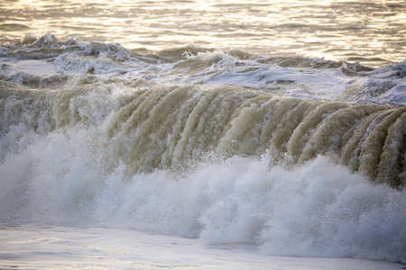 Dirty large crashing waves along the coast after a southerly has been through