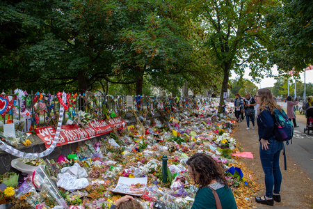 Christchurch, Canterbury, New Zealand, March 29 2019: People walk past the flower wall along Rolleston Ave after the memorial service for the victims of the Christchurch mosque shootings