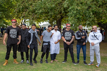 Christchurch, Canterbury, New Zealand, March 22 2019: Mongrel Mob gang members show support and friendship to muslim people at the prayer service in Hagley Park one week after the mosque shootings 新闻类图片