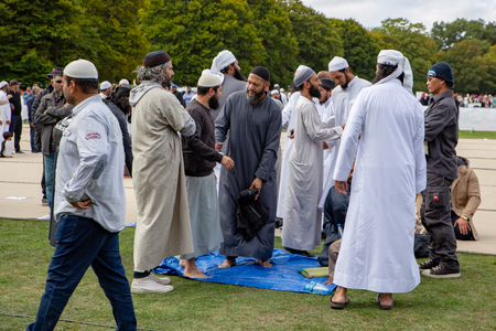 Christchurch, Canterbury, New Zealand, March 22 2019: Muslim men greet each other at the service in Hagley Park to remember the victims of the mosque shootings