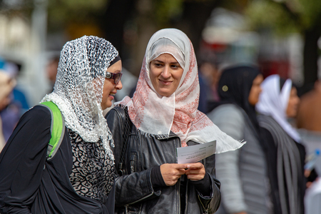 Christchurch, Canterbury, New Zealand, March 22 2019:Muslim women greet each other at the Prayer Service in Hagley Park to remember the victims and families of the Christchurch shootings one week ago