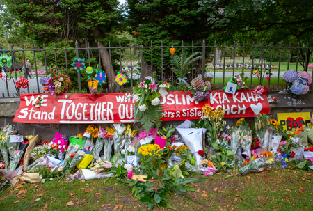 Christchurch, Canterbury, New Zealand, March 29 2019: The flower wall along Rolleston Ave after the memorial service for the victims of the Christchurch mosque shootings 新闻类图片