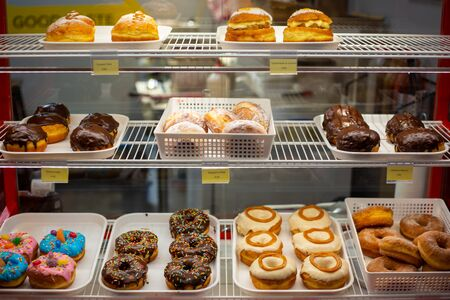 A selection of delicious sweet donuts for sale in a cafe in Christchurch city, New Zealand