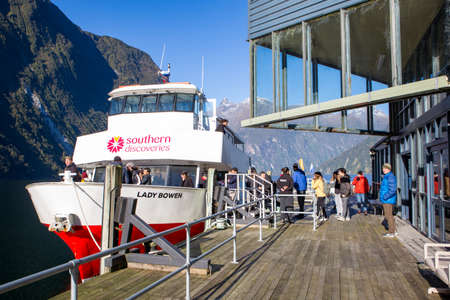Milford Sound, Fiordland, New Zealand, June 20 2020:Tourists boarding the Southern Discoveries cruise boat again after visiting the Underwater Observatory out in Milford Sound