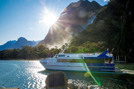 Milford Sound, Fiordland, New Zealand, June 20 2020:Tourists on board a cruise boat heading out into Milford Sound to explore the fjord 新闻类图片