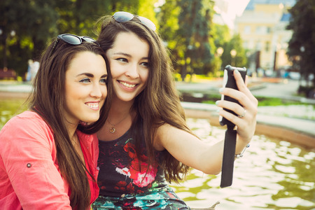 avocation: Two young women taking a selfie outdoors in summer