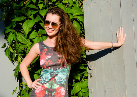 avocation: Smiling young woman outdoors in sunglasses Stock Photo