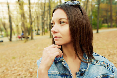 avocation: Hipster beautiful girl in jeans jacket . Fashion girl posing with jacket