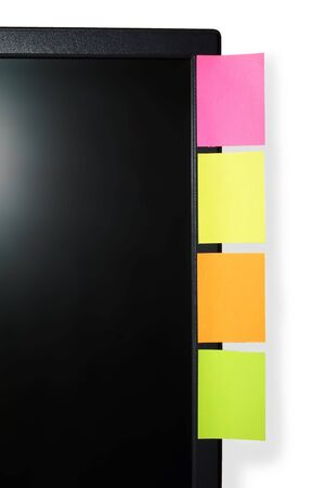 Four colored stickers on monitor isolated on white