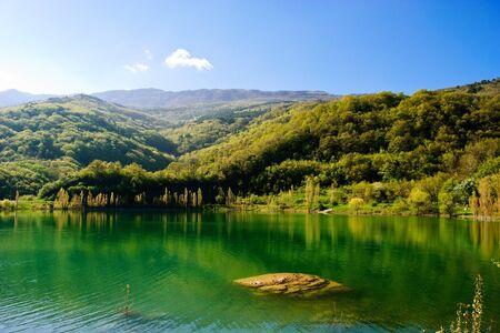 Stone under water in mountain lake
