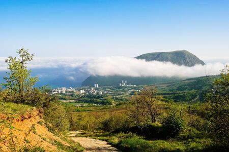 view of the Ayu-Dag mountain in clouds from the town Partenit Stock Photo