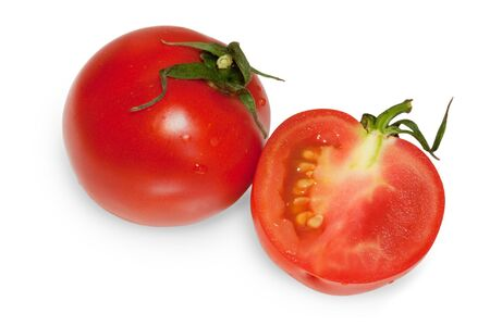 one whole and one half cut tomatoes isolated on white background Stock Photo