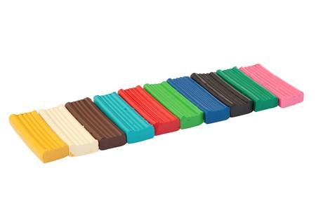 Row of colored plasticine bricks.
