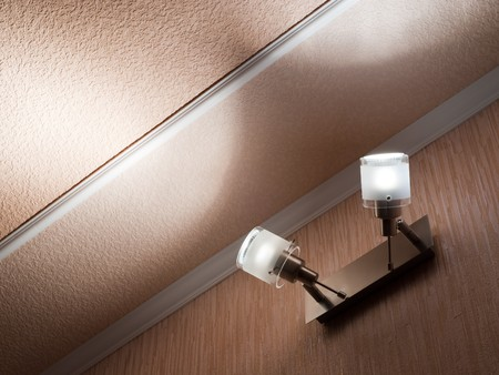 Two modern ceiling lights mounted on a wall