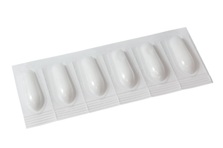 suppository: Rectal suppository in white pack.