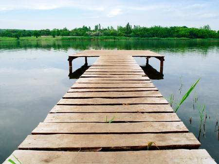 Look on a wooden pier in a lake Stock Photo