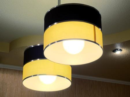 Two modern ceiling lights with energy saving bulbs