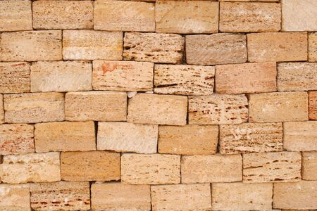 Sand bricks wall. Can be used as texture or background.
