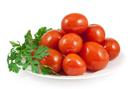 Pickled red tomatoes with green parsley. Isolated on white background Stock Photo