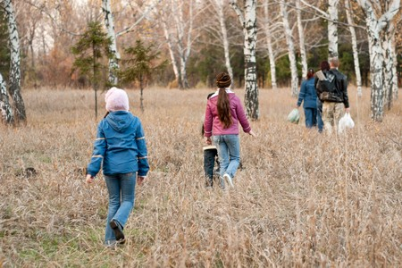 Family goes on a picnic in the autumn woods  Stock Photo