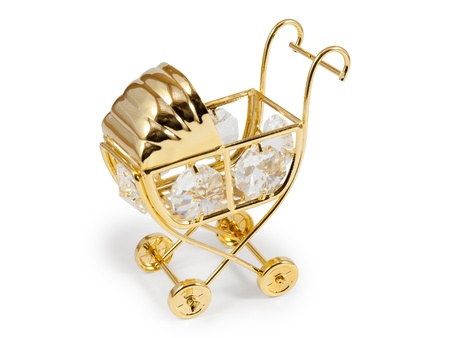 Golden stroller with crystals. Isolated on white background with clipping path.  photo