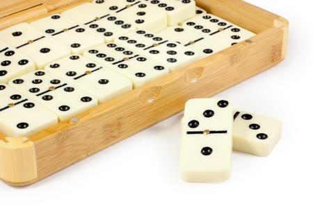 Opened bamboo box with domino  版權商用圖片