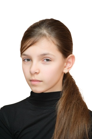 Portrait of teenage girl looks suspiciously. Isolated on white background.