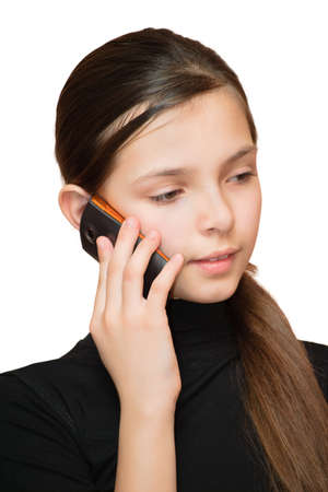 Young teen girl calling by phone. Isolated on white background.