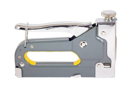 Heavy duty steel staple gun with yellow grip. Isolated on white background with Clipping Path.