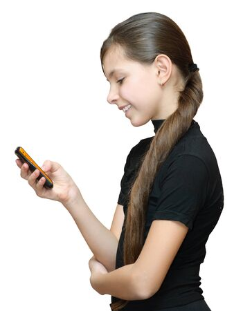 Teenage girl typing sms on the mobile phone. Isolated on white background.